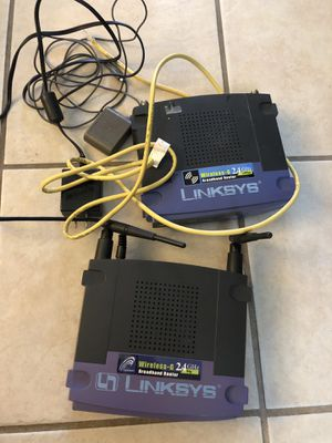 (2) Linksys Broadband router 2.4ghz and cables (only what is pictured) for Sale in Houston, TX