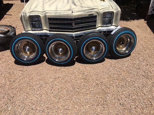 13x7 Center Gold wire wheels rolling on Brand New 155x80x13's