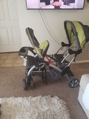 Sit n' stand double stroller for Sale in Fresno, CA