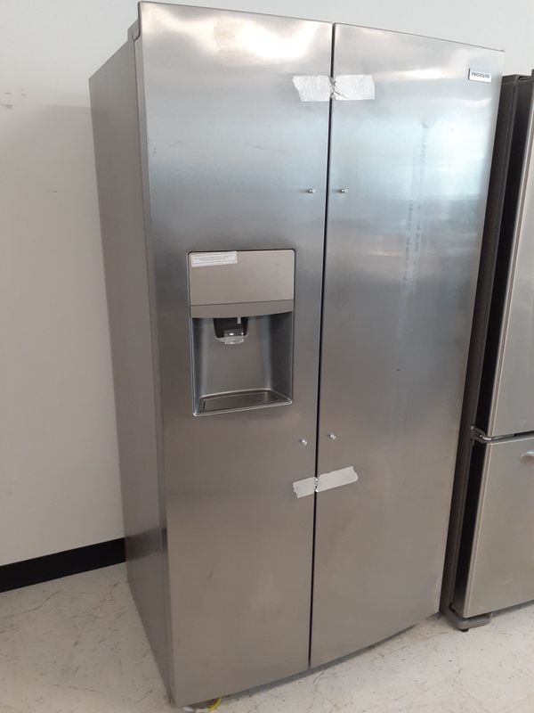 Frigidaire stainless steel side by side refrigerator new with 6 months warranty