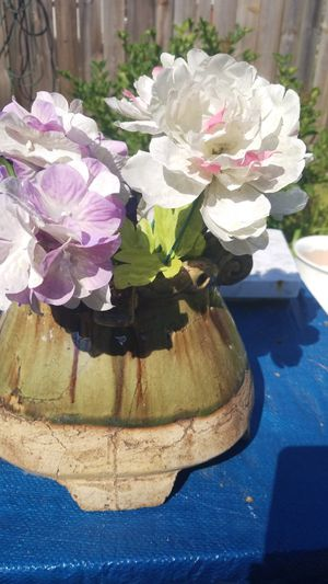 Solid Clay Pot about 15 in long and 7 in wide great back door piece dirt is in the pot with artificial flowers ready to go for real flowers for Sale in North Ridgeville, OH