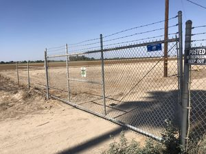 Chain link rolling gate plus side piece for Sale in Fowler, CA
