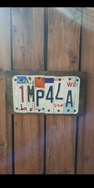 LICENSE PLATE ART ON ONE INCH PINE WOOD WE CAN PUT ANY WORDS YOU WOLD LIKE for Sale in Fontana, CA