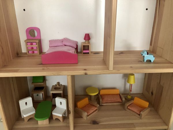 Wooden doll house and figures