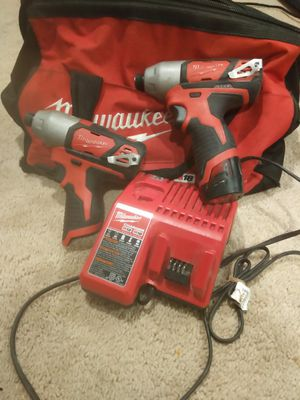Two impact drilles 12 volt Milwaukee and battery.. for Sale in Forest Heights, MD