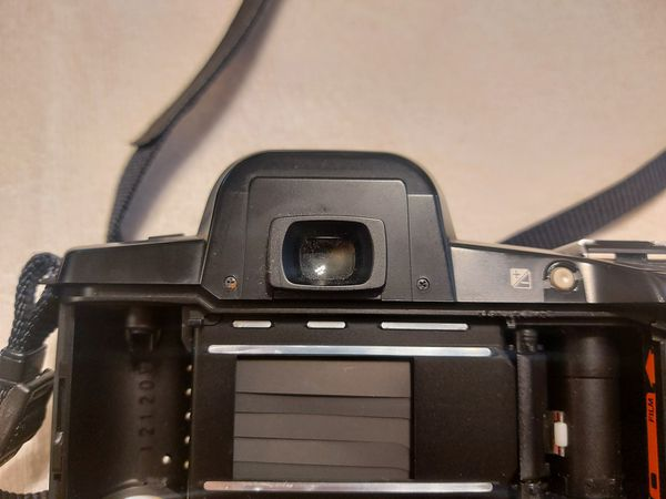 PENTAX Z-10 SLR Film CAMERA (body- one slight crack towards the top, but it does not affect the camera itself) and lense for $45.00 or best offer
