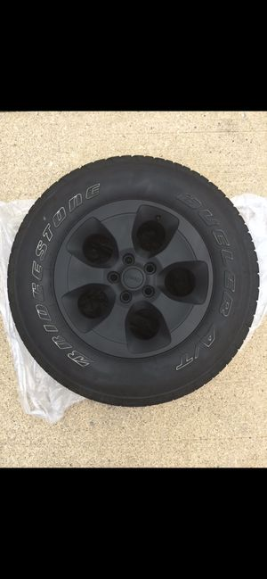 """5 18"""" Jeep Wrangler Wheels, 1 comes with never used tire for Sale in Olmsted Falls, OH"""