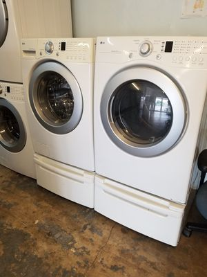 LG front loads washer and dryer electric with pedestals for Sale in Houston, TX