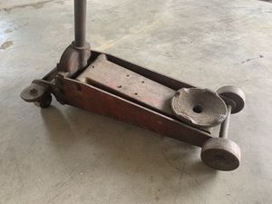 Old floor jack. All steel and super heavy. Is slowly releasing so will need repaired for Sale in Knoxville, MD