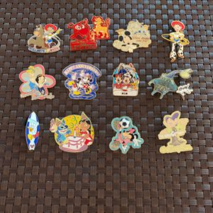 12 Collectible Disney Pins With Backings for Sale in Delray Beach, FL