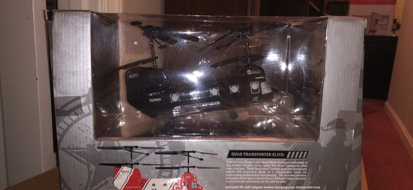 Never used remote helicopter Quad Transporter Elite