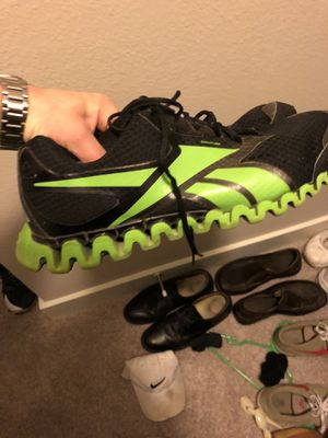 Black and neon nike running shoes size 13 for Sale in Dallas, TX