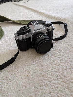 Canon AE-1P Film Camera + Two lenses and flash bar for Sale in Columbia, MD