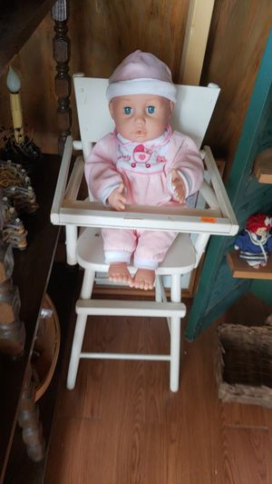 Babydoll and wooden highchair for Sale in Farmville, VA