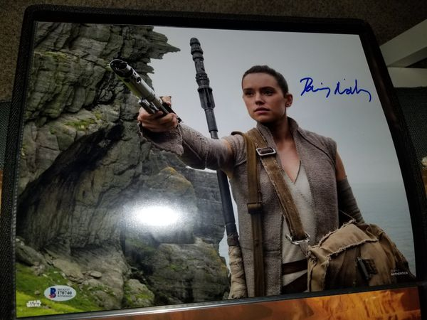 11x14 Star Wars image Signed by Daisy Ridley