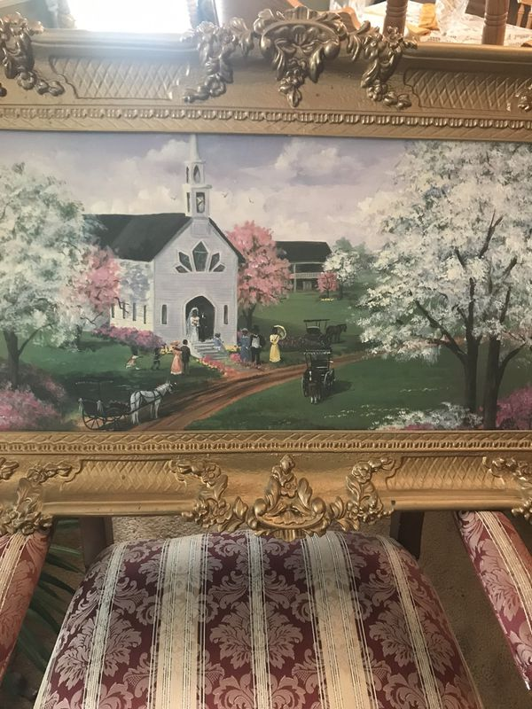 Gold framed photo of Church with Black church goers. There is a second picture similar to the one on The show Good Tim