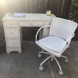Small desk. Ideal for a sewing table because of many drawers. Really cute. Wicker chair. for Sale in Laguna Beach, CA