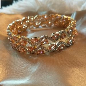 Gold plated bracelet with silver & peach stones for Sale in Alexandria, VA