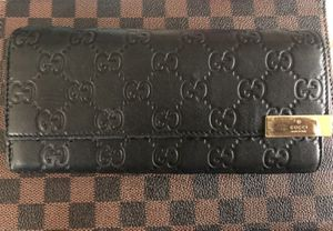 MAKE ME AN OFFER* WOMANS BLACK LEATHER GUCCI WALLET NO RIPS OR TEARS STRAPS NOT INCLUDED $75.00 LOCATED IN SAN CLEMENTE NEED TO SELL ***PICK UP ONLY* for Sale in San Clemente, CA