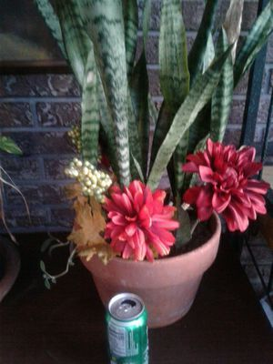 Terra cotta pot planter with mother tongue and fall fake flowers for Sale in Seffner, FL