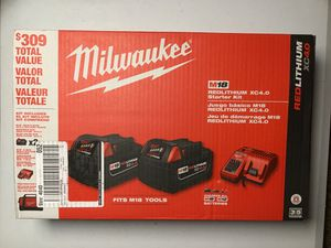 Milwaukee batteries, charger and contractor bag. for Sale in Portland, OR