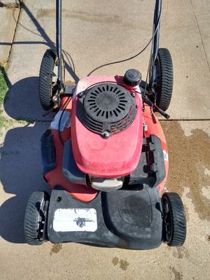 Troy-Bilt Honda powered self-propelled gas lawn mower runs great from the first pull needs some cables and a wheel as is needs work for Sale in Phoenix, AZ