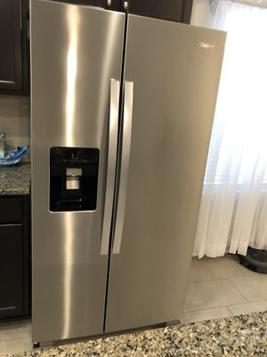 Stainless Whirlpool Side by Side Refrigerator with in door water and ice maker. for Sale in Middleburg, FL