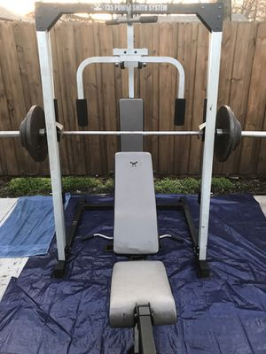 Smith machine with cable system and fly station. Comes with bench, 2 attachments and 240lbs Olympic weight for Sale in Fort Worth, TX