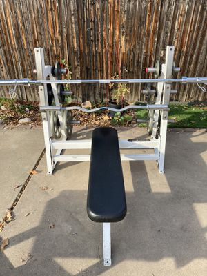 Gym quality weight bench and olympic weight set and curl bar for Sale in Westminster, CO