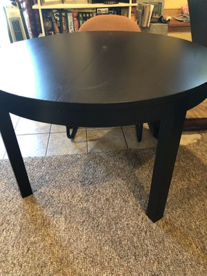 IKEA Espresso Extendable dining table Round/Oval seas up to 6 for Sale in Tacoma, WA