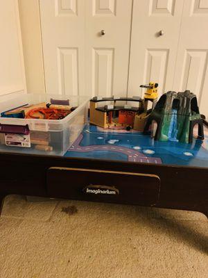 Imaginarium train tracks table with toys for Sale in Arlington, VA
