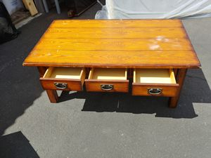 Solid wood coffee table with drawers for Sale in Phoenix, AZ