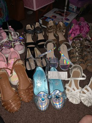 23 pairs of girls size 1 shoes new and used for Sale in Phoenix, AZ
