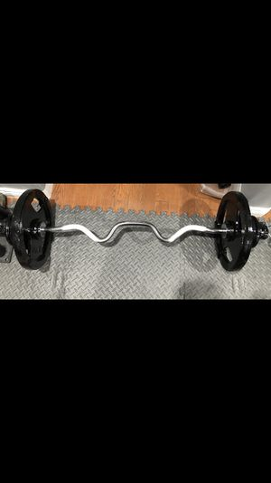 Two 35s, four 5s, four 2.5s, super curl bar, and fast locking collars Olympic Barbell and Olympic Weights/ Plates for Sale in San Gabriel, CA