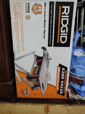 RIDGID 6.5 Amp Corded 7 in. Table Top Wet Tile Saw with Stand for Sale in Gambrills, MD