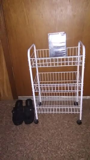 3 shef rack with wheels 2 feet tall 15 inches wide 10 inches deep for Sale in Davenport, IA