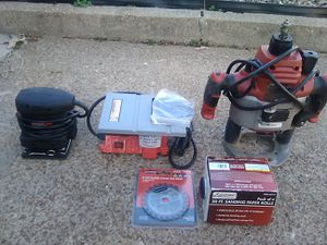 Assorted power tools, saw blades. router, 1 bullnose cuter and 1 inch sandpaper. A mini saw table for Sale in St. Louis, MO