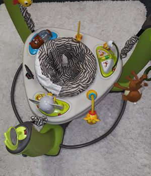 BABY EXERSAUCER JUMPER WITH LOTS OF TOYS! for Sale in Palm Springs, FL