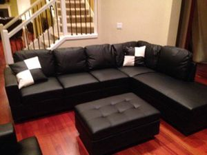 Black leather sectional couch and ottoman for Sale in Seattle, WA