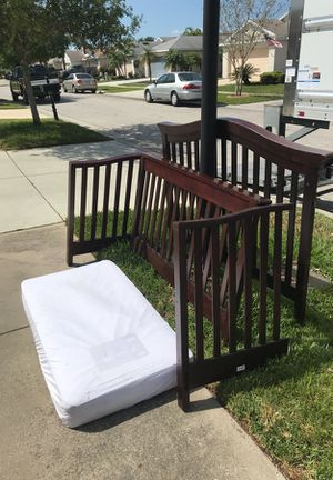 Infant bed/crib combo. Real nice wooden set. Cost over 600. Has a few scratches and scuffs that can be refinished easily. Clean mattress has always b for Sale in Tampa, FL