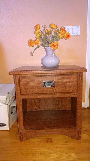 Small cabinet with artificial flowers and base for Sale in Inglewood, CA