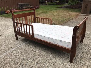 Toddler bed with waterproof mattress and comforter sheet set included. for Sale in Tacoma, WA