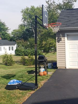 Nice size basketball hoop [we take apart-3pc-and haul] for Sale in Bristow, VA