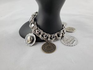 Sterling silver charm bracelet 8 inches 35 grams for Sale in Arvada, CO