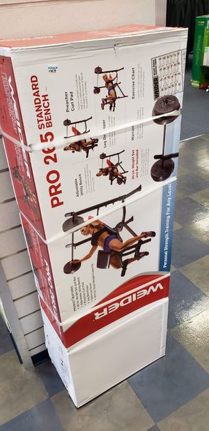 Weider pro 265 weight bench. With 80 pounds and bar included. for Sale in Black Diamond, WA