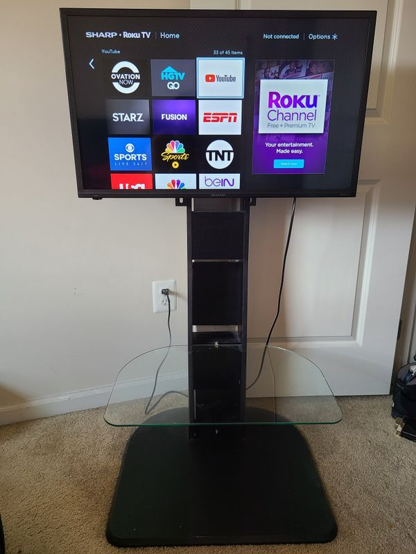 Wooden mount TV stand with Sharp Roku TV
