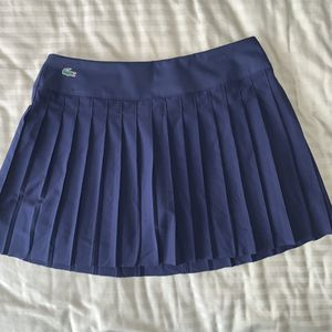 2 Lacoste tennis skirts (white & navy) for Sale in Sterling, VA