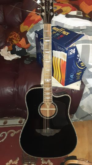 Player by Keith urban acoustic guitar for Sale in Parker, CO
