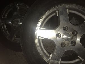 3 Jeep tires and rims 235/65/r17 for Sale in West Chicago, IL