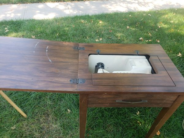 Free singer sewing machine or use as end table